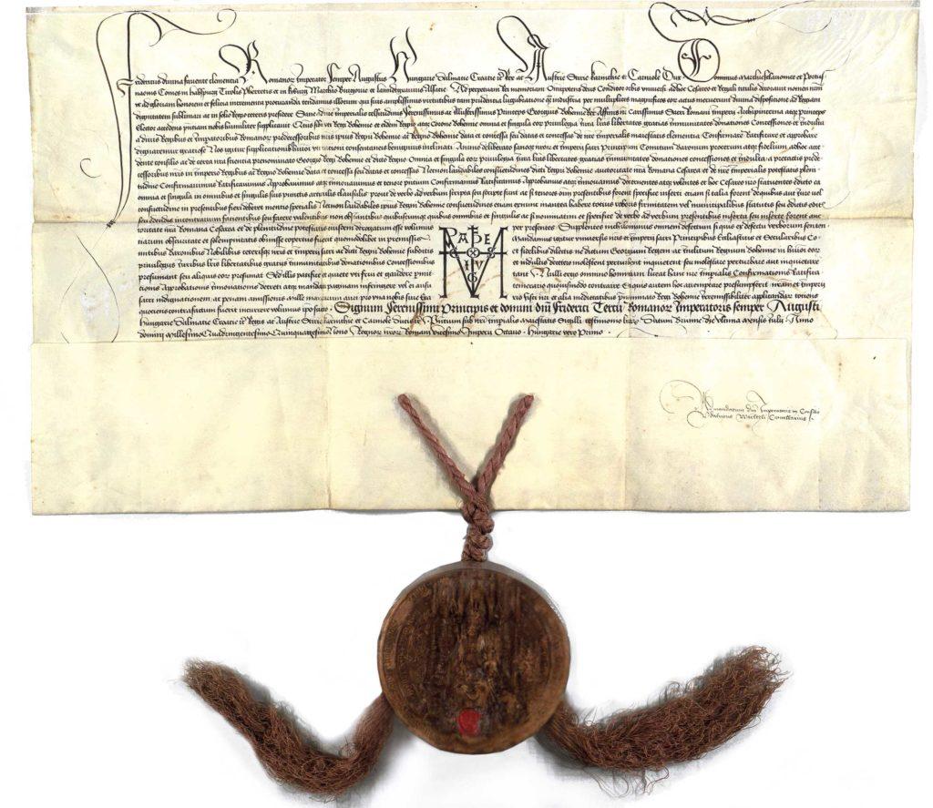 Fridrich III., římský císař, potvrzuje Jiřímu, českému králi, arcičíšníkovi a kurfiřtu-voliteli Svaté říše římské, všechna privilegia, která obdrželi čeští králové od římských králů a císařů