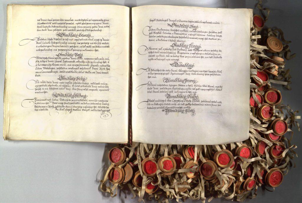 Zástupci stavů zemí České koruny přijímají novou společnou ústavu českého státu, který se stává konfederací